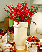 Bouquet of Ilex branches, Malus ornamental apple and rosehip rose