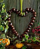 Door wreath, chestnut heart on wire threaded