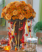 Basket amphora with bouquet of roses and autumn chrysanthemums