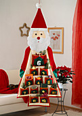 Advent calendar Santa Claus with bags for little gifts