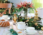 Table decoration garland of fir branches, Hedera ivy, Pinus pine, straw star