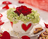 Valentine with heart cup filled with rose