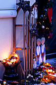 Christmas decoration at the entrance with sledge and angel