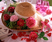 Deco with roses, straw hat with historical roses, alchemilla