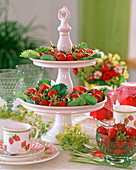 Porcelain etagere with strawberries, Alchemilla (lady's mantle)