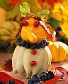 Ornamental pumpkin with prunus (sloe), pink (dogrose)