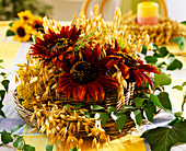 Wicker basket with oats, Helianthus annuus, basket with foil lining