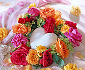 Heart-shaped wreath with various rose petals and hydrangea