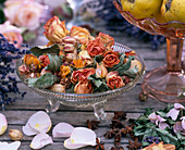 Glass bowl with dried flowers, roses, calendula