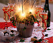 Oxalis deppei 'Iron Cross' decorated with sparklers, champagne glasses