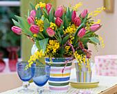 Tulipa 'Barcelona' (Tulips, Acacia (mimosa) in a vase