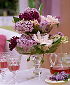 Syringa (lilac), Rose 'New Dawn', Convallaria (lily of the valley) in glass
