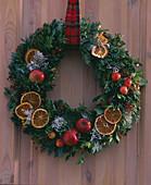 Door wreath with apples and orange slices