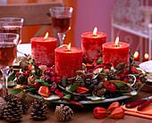 Advent wreath with cones, branches and red candles