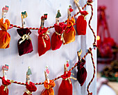 Felt bag with numbered clips attached to string as an advent calendar