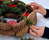 Straw blank as advent wreath pasted with cones - fill gaps with moss