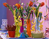 Tulipa 'Princess Irene', Vaccinium in wave bottles,