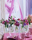 Small bottles with viola panola (pansies)