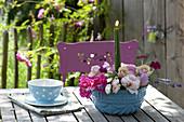 Arrangement of flowers of Rosa (Rose), Lavandula (Lavender), Malva