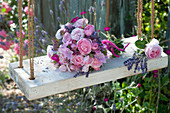 Romantic bouquet made of roses, Malva (mallow), Lavandula