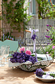 Wire basket with lavandula (lavender) and flowers of pink