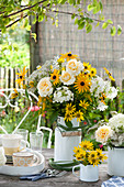 White-yellow bouquet in enamelled milk jug,