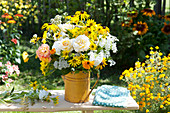 Rural bouquet in yellow tin can