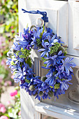 Blue door wreath made of Agapanthus (lily), Sedum