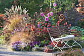 Autumn bed with perennials, grasses and dahlia