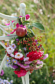 Small bouquet of Aster (white wood aster), rose (rosehip)