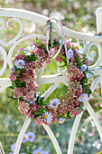 Small wreath of sedum and aster (white wood aster)