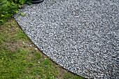 Gravel area bounded by iron in the soil