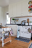 White, vintage-style country-house kitchen
