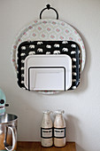 Trays in magazine rack hung on wall