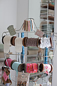 Reels of vintage-style trims and ribbons hung from tailors' dummy