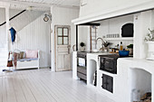 Old wood-fired kitchen stove in open-plan, Scandinavian, country-house kitchen