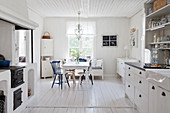 Dining table in open-plan, Scandinavian, country-house kitchen