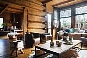 Leather armchairs and animal-skin rugs in comfortable lounge area of dacha