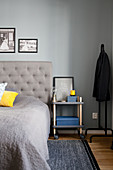 Bedside table on castors in bedroom in shades of grey