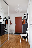 Mirrored wardrobe in foyer with red front door