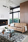 Beige leather room and retro coffee table in the living room with fireplace