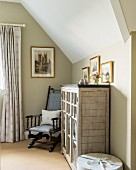 Antique armchair and vintage bookcase