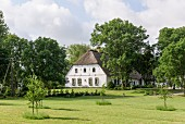 Gable end of traditional Frisian 17th-century farmhouse in gardens