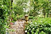 Vintage garden furniture on cobbled terrace