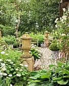 Vintage-style cobbled terrace in garden