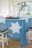 A blue tablecloth with large white stars