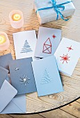 Embroidered Christmas cards on a wooden table