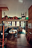 Dining room with corner bench and collection of medicine balls on the shelf