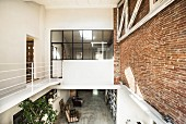 Gallery level in loft apartment with brick wall