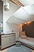 Teenager's bedroom with white awning over bed